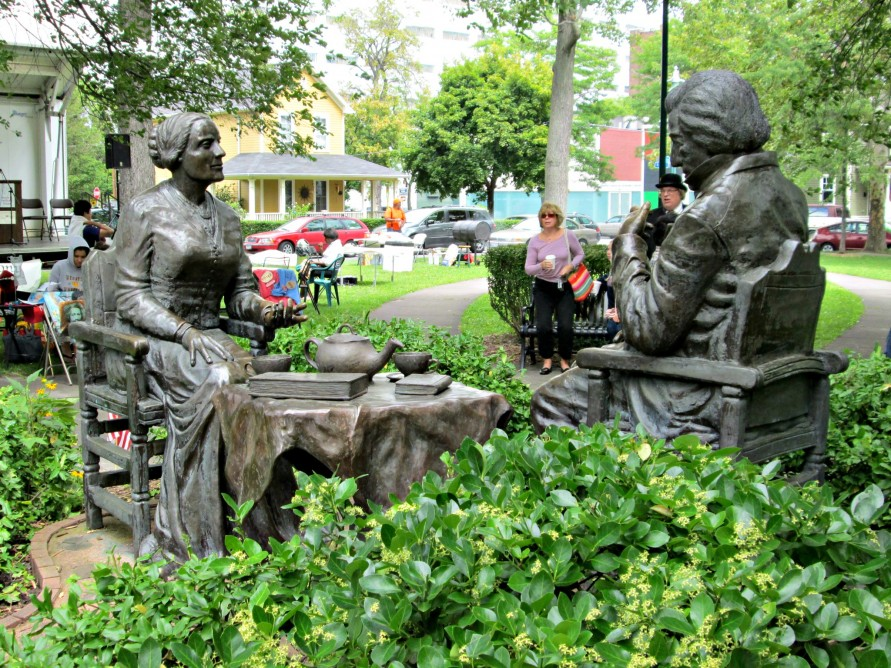 """""""Let's Have Tea."""" by Pepsy Kettavong. The bronzed statue depicts Susan B. Anthony and Frederick Douglass having tea. Located in Susan B. Anthony Square Park"""