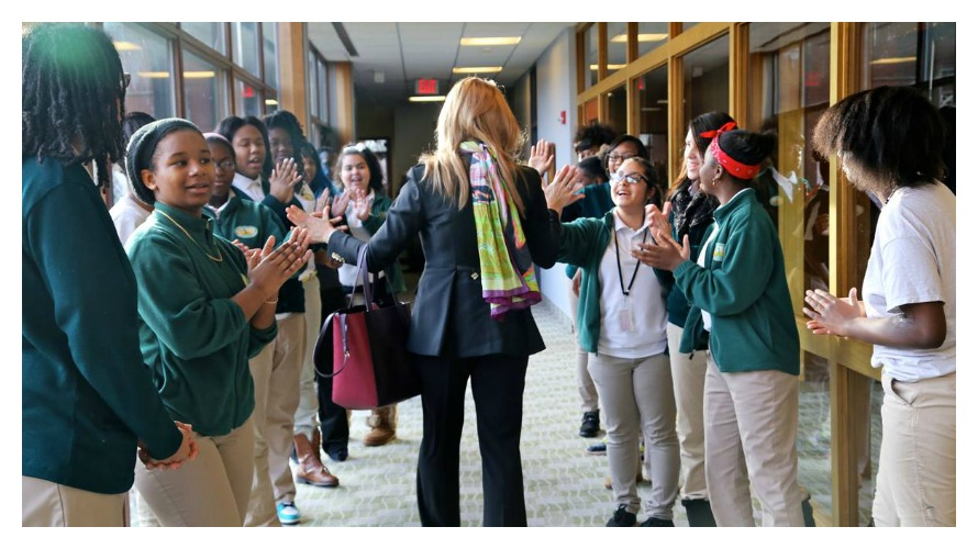 ARC founder and team mentor Gail Riggs being cheered by students after the Young Women's College Prep Leadership Breakfast in December. (photo cred: Rochester Democrat and Chronicle)