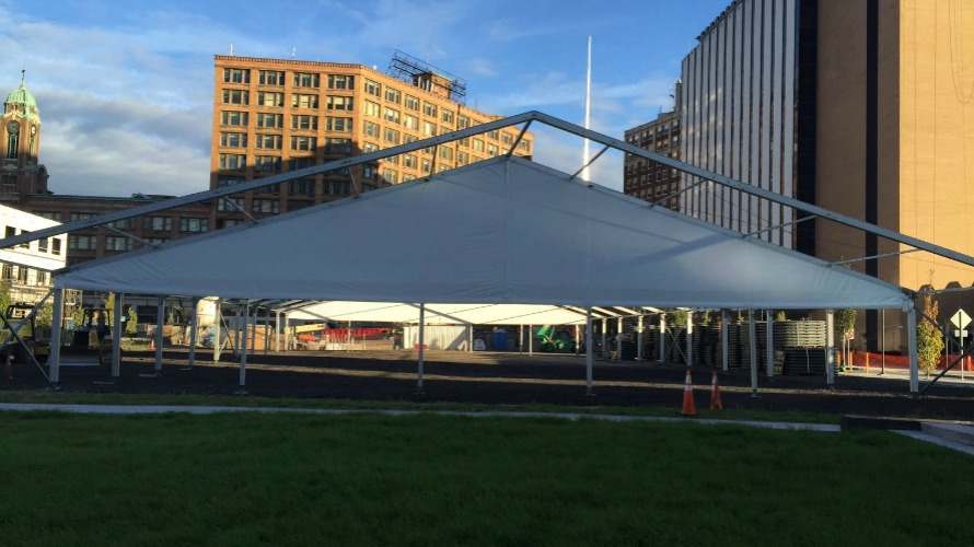 The Tents On Main being set up across from the Sibley Building in downtown Rochester